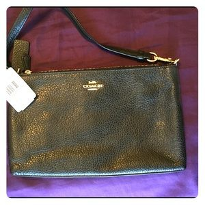 Coach black leather clutch/wristlet